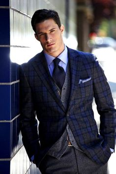The blue shirt, black polka dot tie, wool gray sweter vest and pants, and a beutiful finish in the blue plaid jacket.