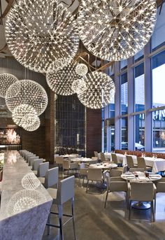 I'm loving this Restaurant design, especially the lighting fixtures! Urszula Tokarska and Stephen R. Pile Architect, made extensive use of the Raimond lamps from Moooi in their design for the Aria Ristorante in Toronto, Canada. Hula Hoop Chandelier, Dining Chandelier, Chandelier Ideas, Luxury Chandelier, Globe Chandelier, Luminaire Design, Deco Design, Design Design, Cafe Design