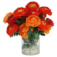 Silk red and orange ranunculus in a vase with faux water.    Product: Faux floral arrangementConstruction Material: ...