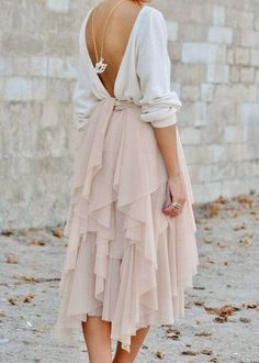Layered chiffon nude skirt with open back top.