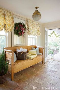 By decorating the mudroom, holiday cheer greets guests the minute they enter.