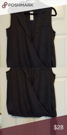 Ann Taylor sleeveless cross front blouse Navy blue with white design.  Decorative tie at the bottom. Ann Taylor Tops Blouses
