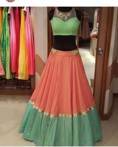 Attractive color combination with tassels on the hem of the blouse Half Saree Designs, Choli Designs, Lehenga Designs, Blouse Designs, Indian Designer Outfits, Indian Outfits, Designer Dresses, Half Saree Lehenga, Red Lehenga