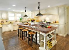 Love the lightness of this kitchen and the island!!