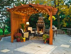 pergola privacy + outdoor fireplace  http://rusticbackyardstructures.com