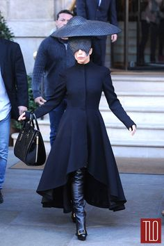The thing on her head is silly, but the coat is fab.  Coat Porn: Lady Gaga in Alexander McQueen in London | Tom & Lorenzo Fabulous & Opinionated