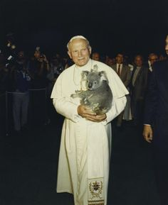 Too much awesome for one picture. JPII holding a koala!
