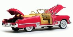 1949 Cadillac Series 62 Convertible From fairfieldcollectibles.com / Diecast has opening hood, doors and trunk. Miniature V-8, bold egg-crate grille and those radical tailfins that set a styling trend for the next decade.