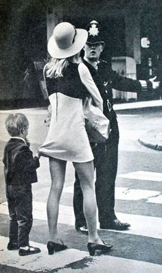 Child holding his mother's mini skirt in the street of London, 1968.