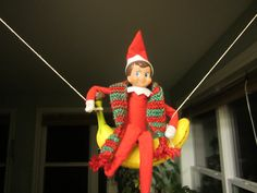Elf on the Shelf makes a banana swing  All your Elf on the Shelf Ideas from Valley Family Fun www.ValleyFamilyFun.ca