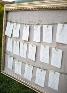 nice seating plan idea - but maybe mini clothes pins on pretty twine instead? and flowers over the top