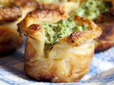 These Puff Pastry Spinach Cups are made in your muffin tin and they couldn't be easier or more delicious. Everyone will love these bite sized treats.