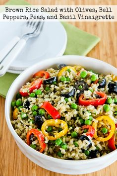 I first made this seriously yummy Brown Rice Salad with Olives, Bell Peppers, Peas, and Basil Vinaigrette about 10 years ago for a wedding shower, and I've been making it ever since then for summer holiday parties and family events. If you want a lower-carb version of the salad, use more peppers and olives and less peas and rice. [from KalynsKitchen.com]