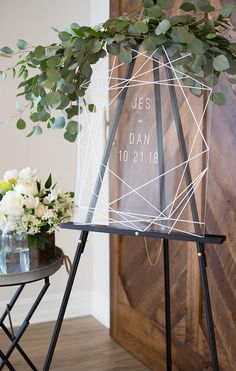 This clear acrylic glass look wedding sign features a modern geometric design personalized with the couples names and wedding date. The beautiful design is bright and sharp. Display this beautiful sign on an easel or any other creative way you can imagine at the entrance of your