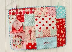 pocket patchwork placemat in red, aqua, and pink by nanaCompany, via Flickr