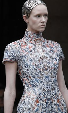 Broken china mosaic dress sewn onto white leather. (For real!) Li Xiaofeng for Alexander McQueen Fashion Show, Fall/Winter 2011. Via Vogue Italy, vogue.it http://www.inspirationgreen.com/reuse-of-old-china.html