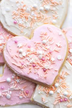 up close heart shaped sugar cookie with pink frosting and sprinkles Heart Shaped Sugar Cookies Recipe, Soft Sugar Cookies, Yummy Cookies, Heart Shaped Cookies, Cookie Desserts, Fun Desserts, Dessert Recipes, Delicious Cookie Recipes, Frosting Recipes