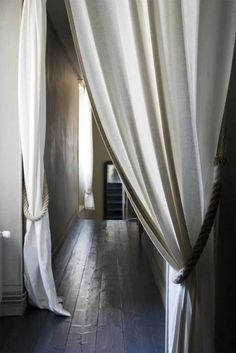 in the winter, hallways get so cold, esp with hardwood floors--but curtains keep heat in and make corridors feel cozy! score! I hope I have a house with lots of back hallways at some point. That would be cool.