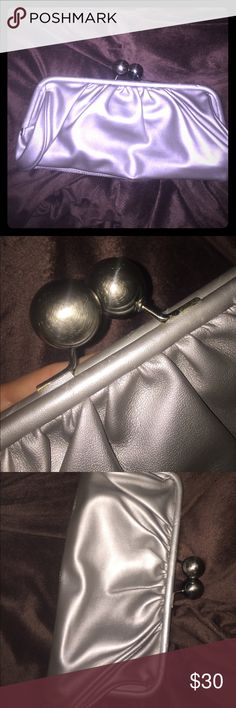 Silver Metro 7 clutch perfect for any occasion Brand new clutch from Urban Outfitters in South Beach. You can either carry it in your hand, under your arm, or over your soldier ! You will adore it Urban Outfitters Accessories