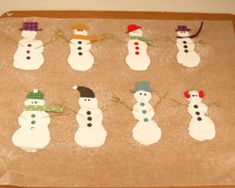 Make your own glue snowmen using Elmer's glue, glitter, and paper embellishments. Use these for gift tags, hanging garland, or even window clings! #wintercrafts