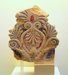 Part of an athemia antefix (architectural ornament) with acanthus leaves on the lower parts. 430BC. Archaeological Museum of Olympia.