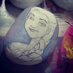Work in progress.. #artbyyatiejoy#stoneart#paintedstones#elsafrozen#paintingstone #art#artist#artistsofinstagram#arts_helps#arrtposts#peeblesart#abstractart#love#instaartexplorer#artist_4_shoutout#stonepainting#rockpainting#arts_help#rare#peebles#rockart#stoneartist#girl#blue#gifts#love#elsa #artsanity #frozen#workinprogress#olaf