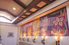 The sanctuary of Congregation Sha'are Zedeck in San Juan, Puerto Rico, featuring tapestries of the 12 Tribes of Israel.