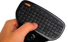 The One Touch Ultra Mini Wireless Keyboard is a palm-sized keyboard which consist of 69 keys with a track ball. The portable and tiny design can be used for travel, school, or any other working environment. It is great for giving presentations or just controlling your PS3.   Read more - http://www.ergonomicsmadeeasy.com/store/mini-keyboards/product/one-touch-ultra-mini-keyboard/
