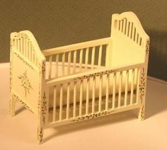 Dollhouse Miniature White Hand Painted Nursery Crib. I would like to repaint to match girl's bedroom furniture and maybe accent it w/ blue