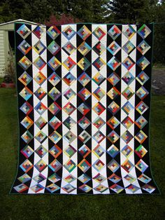 Black & White & Colorful III ~ Log Cabin with a twist Third in a series of log cabin quilts. I had planned to do the blach&white blocks in logcabin technic, too. Love the black and white background stripes! Marvel Comic book Starburst Quilt from Ye Olde S Black And White Quilts, Black White, Scrap Quilt Patterns, Block Patterns, Quilting Ideas, Log Cabin Quilts, Log Cabins, Rustic Cabins, Pineapple Quilt