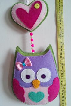 Hand made felt owl  Both sides are decorated. One side of the owl is awake...the other one is asleep. I like the idea for small kids to say Good Morning!! or Good Night!! before going to bed, as part of the sleeping routine.  Estimated measures: 30 cm (11,81 inch) from the top of the heart to the bottom of the owl. The owl is 14 cm (5,512 inch) wide.  Intended for decorative use, NOT A TOY. Please hang out of the reach of small children.  Each ornament is made from felt, carefully…