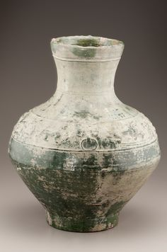 China, Eastern Han dynasty, early 1st-early 3rd century. Tomb jar.  Earthenware with copper-green lead-silicate glaze. H: 43.2, W: 35.0 cm. Smithsonian
