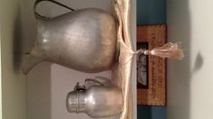 Old tin pitcher & tin syrup container used in Grandmas kitchen.