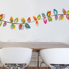 """The Bloemendaal decal set is a pleasant design, ideal for a kid's room or a colorful environment. Easy to install and just as simple to remove, the decals are damage free and can be used on almost any surface. Each design is printed on white vinyl and then cut out, which allows Mia & Co. to create unique patterns in a wide range of colors. The application itself is effortless: just peel off the backing and stick the decal on the wall. 105"""" x 20"""""""