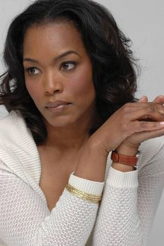 Angela Basset- I think she's so freaking gorgeous and such a GREAT actress!!!! She's almost regal onscreen and has this really classy and respectable way about herself.  Beauty is remaining who you are and always holding yourself to a higher standard.