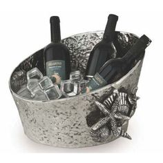 The Coquilles Shell Party Beverage Tub is an ocean inspired beverage tub that brings the seashore to your door. The Coquilles Beverage Tub, decorated with sea shells, is fashioned from nickel-plated cast aluminum and resists turning, tarnishing, pitting, scratching and discoloration.