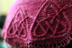 This is the third design in the Celtic Cable Shawls collection. This crescent shawl features an intricate cabled edging inspired by carved knotwork from a Pictish symbol stone. The lower edge of the shawl can either be left plain, or finished with a crochet chain cast-off; the body of the shawl is shaped with short rows. Note that this is quite a small shawl: if you're concerned about it coming out too small, remember to check your gauge carefully before beginning (and block your gauge…