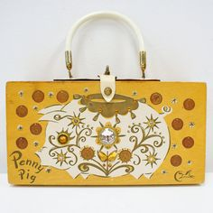 "I love Enid Collins! I have one of her pieces but this ""Penny Pig"" Box Handbag (via Etsy) is too cute for words."