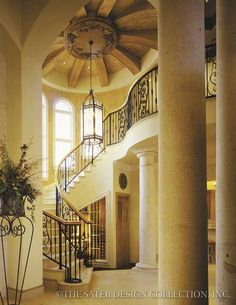 GRAND FOYER - Florentino by Sater, wine cellar in staircase.... yes please & thank you!