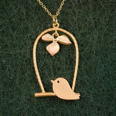 16K gold bird necklace from Etsy. Adore.