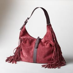 """HEARTLAND FRINGED HOBO BAG--Long, sassy fringe, rustling in the breeze, adds a hint of the Wild West and a free spirited sense of abandon to this classic, suede, fringed hobo bag. Italy. Exclusive. Approx. 17-1/2""""W x 1""""D x 12""""H."""