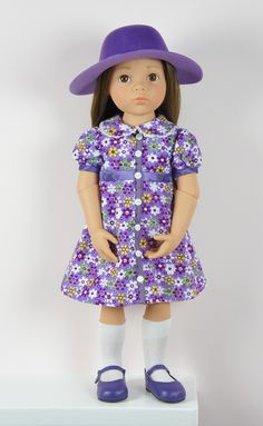 The beautiful Gotz Happy Kidz Sophie modelling Bonnie & Pearl's Purple Floral Dress Set http://www.petalinadolls.co.uk/hannah-sarah/hannah-sarah-dolls/gotz-happy-kidz-sophie-jointed-ballerina-doll.htm?q=sophie&search-submit=&detailed=1