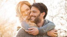 woman hugging husband both smiling