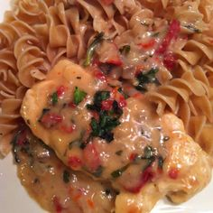 Dinner tonight... Creamy Chicken with sundried tomatoes and Basil served over whole wheat egg noodles :)