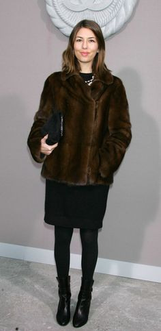 Not sure if I could rock the Margot Tenenbaum coat, but I am loving the black dress-tights-booties combo!