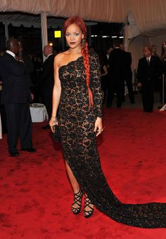 Rihanna - a one-shoulder floral embellished gown at the 2011 Met Gala. A side sweeping long braid completed her elegant look. (Brand: Stella McCartney)