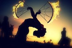 Fire fan dancer