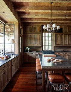 River-recovered sinker cypress walls and shotgun shell trim on the zinc-topped island delight in the kitchen.