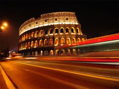 Colosseum at night in Rome, Italy. Colosseum and traffic lights at night in Rome , Rome Tours, Day Tours, City Road, Trevi Fountain, Shore Excursions, Weekend Breaks, Rome Travel, Traffic Light, Rome Italy