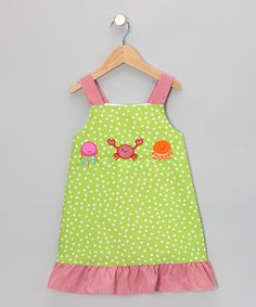 This dress has pretty polka dots and ruffled hems that bring a ray of sunshine into every room. With thick, no-slip straps and a roomy fit, it boasts an airy fit that's great for lots of play.65% polyester / 35% cottonMachine wash; tumble dryMade in El Salvador